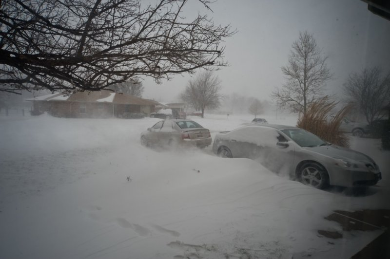 None of these vehicles were running... what appears as steam is blowing snow wrapping around the front of the house.