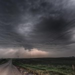 Severe thunderstorm starts producing lightning near Lindy, Nebraska.